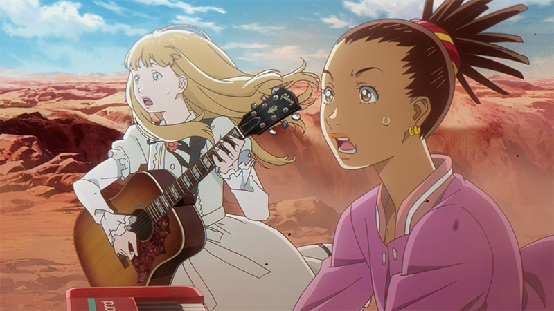 Carole (right) and Tuesday (left) stand in the desert, staring in shock at something off screen, holding their instruments.